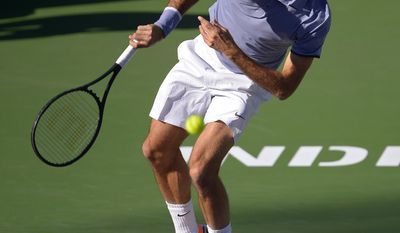 Roger Federer, of Switzerland, serves to Paul-Henri Mathieu, of France, during their match at the BNP Paribas Open tennis tournament, Saturday, March 8, 2014, in Indian Wells, Calif. (AP Photo/Mark J. Terrill)