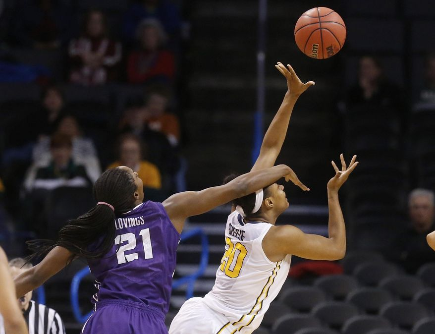 West Virginia center Asya Bussie (20) is fouled by TCU center Latricia Lovings (21) on a shot during the second half of an NCAA college basketball game in the quarterfinals of the Big 12 Conference women's tournament in Oklahoma City, Saturday, March 8, 2014. West Virginia won 67-59. (AP Photo/Sue Ogrocki)