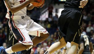 Mississippi guard Jarvis Summers (32) attempts a layup as Vanderbilt forward Shelby Moats (34) defends in the first half of an NCAA college basketball game in Oxford, Miss., Saturday, March 8, 2014. (AP Photo/Rogelio V. Solis)