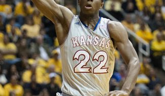 Kansas' Andrew Wiggins (22) drives to the basket during the first half of an NCAA college basketball game against West Virginia, Saturday, March 8, 2014, in Morgantown, W.Va. (AP Photo/Andrew Ferguson)