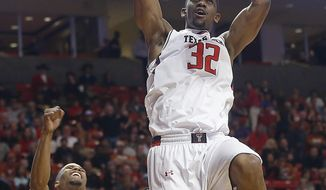 Texas Tech's Jordan Tolbert dunks in front of Texas' Martez Walker (24) and Texas Tech's Jaye Crockett (30) during an NCAA college basketball game in Lubbock, Texas, Saturday, March 8, 2014. (AP Photo/Lubbock Avalanche-Journal, Zach Long)