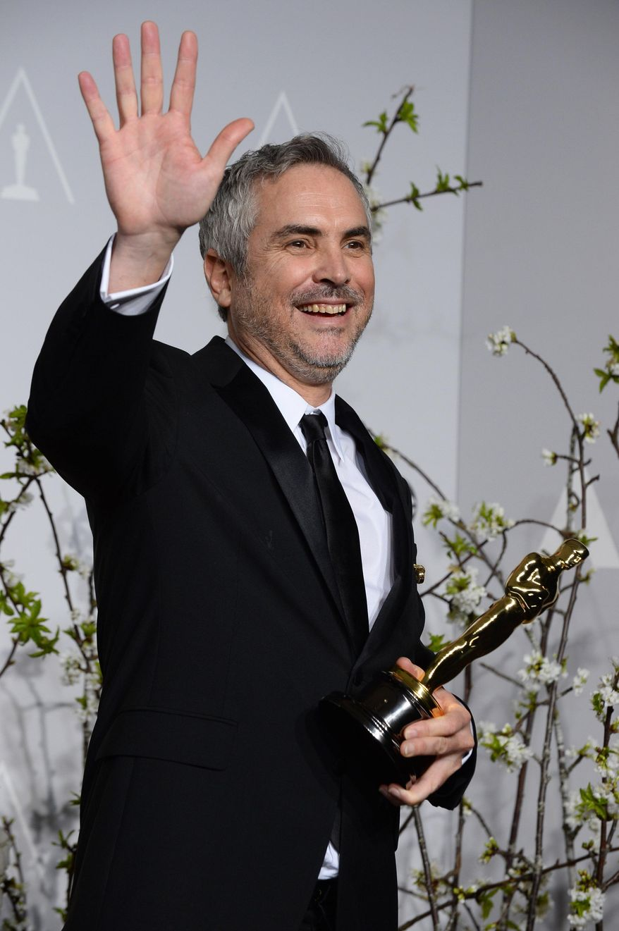 """FILE - In this Sunday, March 2, 2014 file photo, Alfonso Cuaron poses in the press room with the award for best film editing for """"Gravity"""" during the 86th Academy Awards at the Dolby Theatre, in Los Angeles. Cuaron and J.J. Abrams (""""Lost,"""" the """"Star Trek"""" movies) are executive producers of the new NBC television series, """"Believe,"""" a drama about a child whose supernatural powers put her and the world at risk. (Photo by Jordan Strauss/Invision/AP, file)"""