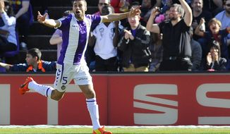 Valladolid's Italian midfielder Fausto Rossi celebrates scoring during a Spanish La Liga soccer match against Barcelona at the Jose Zorrilla stadium in Valladolid, Spain on Saturday March 8, 2014. (AP Photo/Israel L. Murillo)