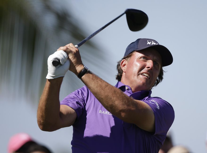 Phil Mickelson hits from the 17th tee during the third round of the Cadillac Championship golf tournament Saturday, March 8, 2014, in Doral, Fla. (AP Photo/Wilfredo Lee)