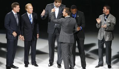 Troy Aikman, Roger Staubach, Dirk Nowitzki, Rolando Blackman and Michael Young congratulate Mike Modano as Modano's No. 9 Dallas Stars jersey is retired, before the NHL hockey game between the Stars and the Minnesota Wild in Dallas on Saturday, March 8, 2014. (AP Photo/ Richard W. Rodriguez)