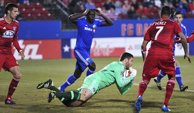 FC Dallas goalkeeper Chris Seitz grabs the ball away from danger during an MLS soccer game against the Montreal Impact on Saturday, March 8, 2014, in Frisco, Texas. (AP Photo/The Dallas Morning News, Matthew Busch) MANDATORY CREDIT; MAGS OUT; TV OUT; INTERNET USE BY AP MEMBERS ONLY; NO SALES