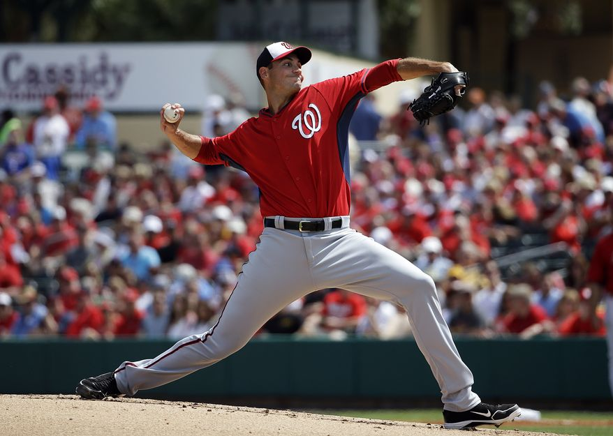 Washington Nationals starting pitcher Chris Young throws during the first inning of an exhibition spring training baseball game against the St. Louis Cardinals, Saturday, March 8, 2014, in Jupiter, Fla. (AP Photo/David Goldman)
