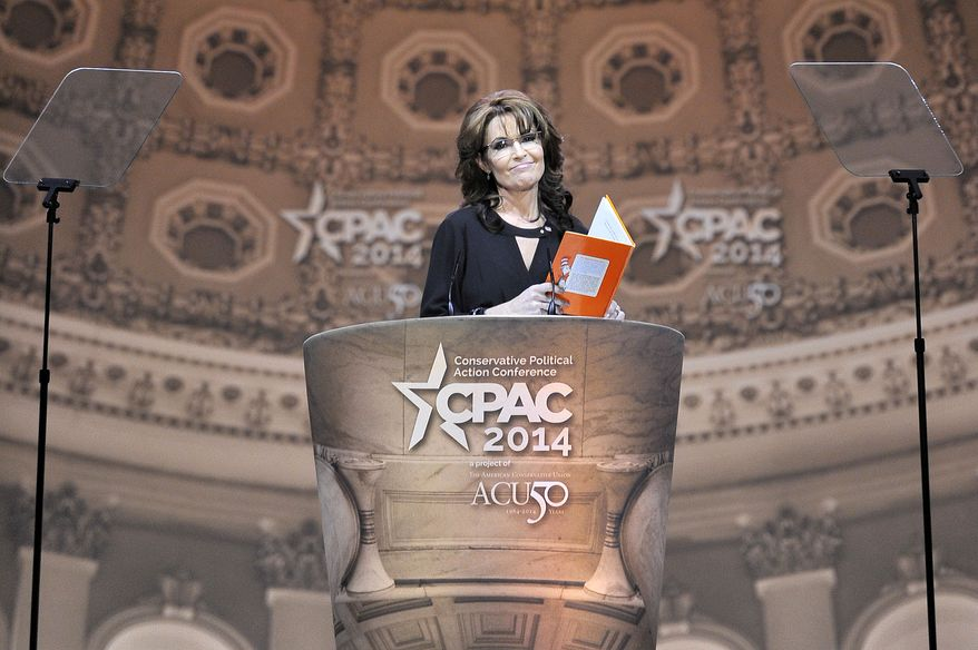 Sarah Palin, former Governor of Alaska, reads an adapted version of Dr. Seuss as she gives the final remarks during the CPAC2014 at The National Harbor, Md. (Preston Keres/Special for The Washington Times)