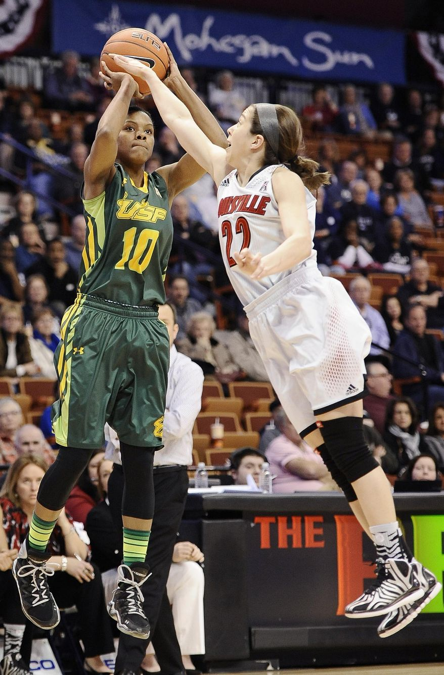 South Florida's Courtney Williams, left, shoots over Louisville's Jude Schimmel, right, during the first half of an NCAA college basketball game in the semifinals of the American Athletic Conference women's tournament, Sunday, March 9, 2014, in Uncasville, Conn. (AP Photo/Jessica Hill)