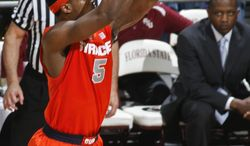 Syracuse forward C.J. Fair (5) makes a 3-point basket in the first half of an NCAA college basketball game against Florida State, Sunday, March 9, 2014, in Tallahassee, Fla. (AP Photo/Phil Sears)
