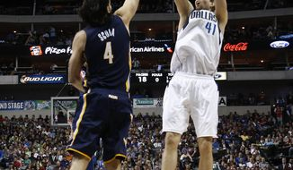 Dallas Mavericks power forward Dirk Nowitzki (41), of Germany, shoots the ball over Indiana Pacers' Luis Scola (4), of Argentina, during the first half of an NBA game, Sunday, Mar. 9, 2014, in Dallas, Texas. (AP Photo/Jim Cowsert)