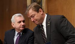 Sens. Jack Reed, Rhode Island Democrat, (left) and Dean Heller, Nevada Republican, were working together on a bipartisan bill in last year to restore unemployment benefits that fell one vote short of overcoming a GOP-led filibuster. (Associated Press)