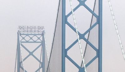 FILE - The Ambassador Bridge is shown in Detroit, Thursday, June 16, 2011.  The omission in the federal budget for funding specifically for a border inspection plaza in Michigan is not expected to delay efforts to build a commuter bridge connecting Detroit with Canada, state officials say. Land acquisition for the New International Trade Crossing could start this summer on the U.S. side of the Detroit River, with bridge construction scheduled to begin in 2016. The project would be completed in 2020. The span would compete for the lucrative cross-border toll revenues in Detroit and Windsor, Ont., mainly being captured by the privately owned Ambassador Bridge. (AP Photo/Paul Sancya)