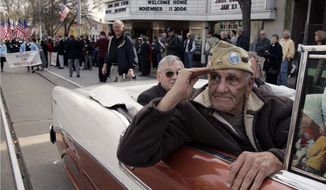 "** FILE ** This Nov. 11, 2004, file photo shows William ""Wild Bill"" Guarnere participating in the Veterans Day parade in Media, Pa. Guarnere, one of the World War II veterans whose exploits were dramatized in the TV miniseries ""Band of Brothers,"" has died, Sunday, March 9, 2014, at the age of 90. (AP Photo/Jacqueline Larma, file)"
