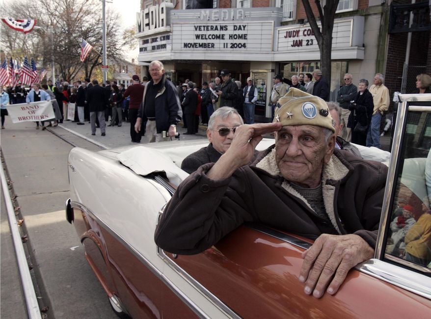 """** FILE ** This Nov. 11, 2004, file photo shows William """"Wild Bill"""" Guarnere participating in the Veterans Day parade in Media, Pa. Guarnere, one of the World War II veterans whose exploits were dramatized in the TV miniseries """"Band of Brothers,"""" has died, Sunday, March 9, 2014, at the age of 90. (AP Photo/Jacqueline Larma, file)"""