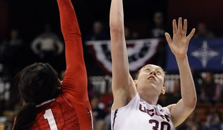 Connecticut's Breanna Stewart, right, scores as Rutgers' Rachel Hollivay, left, defends during the first half of an NCAA college basketball game in the semifinals of the American Athletic Conference women's tournament, Sunday, March 9, 2014, in Uncasville, Conn. (AP Photo/Jessica Hill)