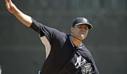 New York Yankees starter David Phelps throws a warmup pitch before a spring training baseball game against the Tampa Bay Rays in Tampa, Fla., Sunday, March 9, 2014. (AP Photo/Kathy Willens)