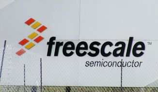 A sign for Freescale Semiconductor is seen in this photo from Austin, Texas on Sunday March 9, 2014. The Austin-based technology company says its 20 employees on board a missing Malaysia Airlines flight were en route to a business meeting in China. Freescale Semiconductor spokeswoman Jacey Zuniga said Sunday that the employees, 12 from Malaysia and eight from China, work at facilities in their respective countries that manufacture semiconductor chips. (AP Photo/John L. Mone)