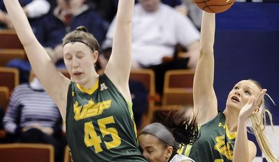 South Florida's Inga Orekhova, right, stops a shot-attempt by Louisville's Tia Gibbs, center, as South Florida's Katelyn Weber, left, defends during the first half of an NCAA college basketball game in the semifinals of the American Athletic Conference women's tournament on Sunday, March 9, 2014, in Uncasville, Conn. (AP Photo/Jessica Hill)