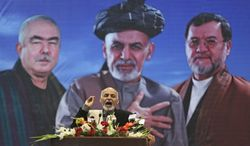 Afghan presidential candidate Ashraf Ghani Ahmadzai speaks during a campaign rally for women a day after International Women's Day in Kabul, Afghanistan, Sunday, March 9, 2014. Ten Afghan presidential candidates are campaigning in the presidential election scheduled for April. (AP Photo/Massoud Hossaini)
