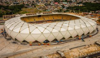 This photo released by Portal da Copa shows Arena da Amazonia stadium on the day of its inauguration in Manaus in the state of Amazonas, Brazil, Sunday, March 9, 2014. Three stadiums still have to be finished, including the one hosting the opener in Sao Paulo in about three months. (AP Photo/Jose Zamith, Portal da Copa)