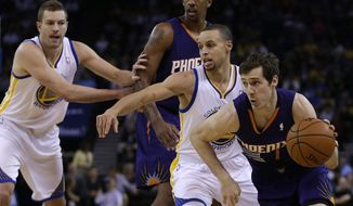 Phoenix Suns' Goran Dragic, right, drives past Golden State Warriors' Stephen Curry, second from right, during the first half of an NBA basketball game Sunday, March 9, 2014, in Oakland, Calif. (AP Photo/Ben Margot)