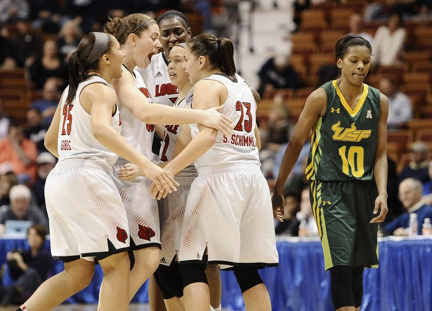Louisville's Tia Gibbs, left, Sara Hammond, second from left, Asia Taylor, back center, Jude Schimmel and Shoni Schimmel (23) celebrate as South Florida's Courtney Williams, right, looks on after Louisville broke a tie in the final seconds of an NCAA college basketball game in the semifinals of the American Athletic Conference women's tournament on Sunday, March 9, 2014, in Uncasville, Conn. Louisville won 60-56. (AP Photo/Jessica Hill)