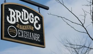 Four new businesses have opened in downtown Linden over the past year, including the Bridge Street Exchange, a men's clothing store specializing in men's wedding bands, which was open for business on Wednesday, Feb. 19, 2014, in downtown Linden, Mich. (AP Photo/The Flint Journal, Katie McLean) LOCAL TV OUT; LOCAL INTERNET OUT