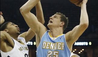 Denver Nuggets center Timofey Mozgov (25) shoots over New Orleans Pelicans power forward Anthony Davis (23) in the first half of an NBA basketball game in New Orleans, Sunday, March 9, 2014. (AP Photo/Bill Haber)