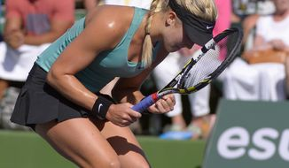 Eugenie Bouchard, of Canada, celebrates her 6-3, 6-3 win over Sara Errani, of Italy, in a match at the BNP Paribas Open tennis tournament on Sunday, March 9, 2014, in Indian Wells, Calif. (AP Photo/Mark J. Terrill)