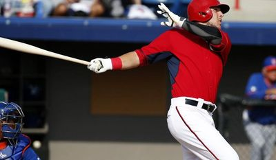 Washington Nationals' Matt Skole, right, watches his two-run homer in the eighth inning of a spring exhibition baseball game against the New York Mets, Wednesday, March 5, 2014, in Viera, Fla. The Nationals won 11-5. (AP Photo/Alex Brandon)