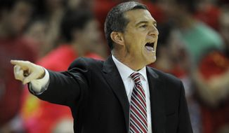 Maryland head coach Mark Turgeon points during the second half of an NCAA college basketball game against Virginia, Sunday, March 9, 2014, in College Park, Md. Maryland won 75-69 in overtime. (AP Photo/Nick Wass)