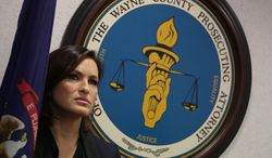 """Actress Mariska Hargitay takes questions after a news conference with Wayne County Prosecutor Kym L. Worthy, at Frank Murphy Hall of Justice in Detroit on Monday, March 10, 2014. The star from NBC's """"Law & Order: Special Victims Unit"""" on Monday said her Joyful Heart Foundation stands with Worthy in her efforts to have thousands of backlogged rape kits tested. The foundation works with authorities on eliminating the testing backlog. Worthy's office says the Sexual Assault Kit Evidence Submission Act legislation is expected to be introduced this month in Lansing. It seeks more timely analysis and testing of evidence contained in rape kits and allows for input from victims. (AP Photo/Detroit Free Press, Romain Blanquart)  DETROIT NEWS OUT;  NO SALES"""