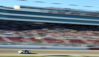 Brad Keselowski drives during qualifying for Sunday's NASCAR Sprint Cup Series auto race on Friday, March 7, 2014, in Las Vegas. (AP Photo/Isaac Brekken)