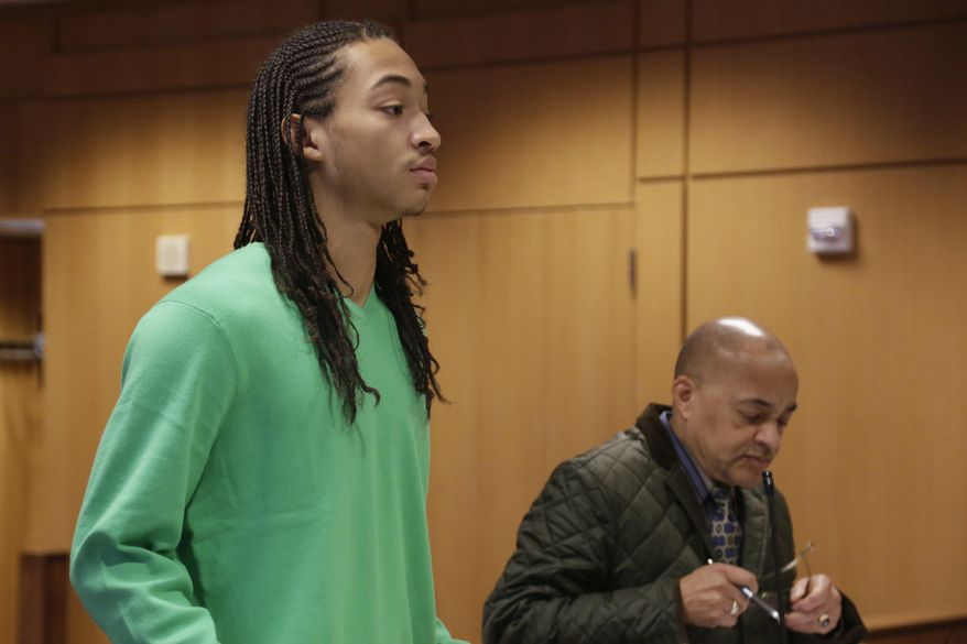 Cass Tech. student Jayru Campbell, represented by Walter Pookrum who is temporarily filling in for Campbell's main attorney Jeffrey Edison, is arraigned at the Frank Murphy Hall of Justice, Monday, March 10, 2014, in Detroit. Campbell is accused of body-slamming a school guard to the ground. (AP Photo/Detroit Free Press, Mandi Wright)  DETROIT NEWS OUT;  NO SALES;  MANDATORY CREDIT