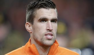 In this Nov. 19, 2013 image Netherlands' Kevin Strootman lines up prior to the  international friendly soccer match between Netherlands and Colombia at ArenA stadium in Amsterdam, Netherlands. In a severe blow to Dutch World Cup hopes, Netherlands coach Louis van Gaal said Monday March 10, 2014, that midfielder Kevin Strootman will miss the tournament after suffering a serious knee injury over the weekend playing for his club AS Roma. (AP Photo/Peter Dejong)