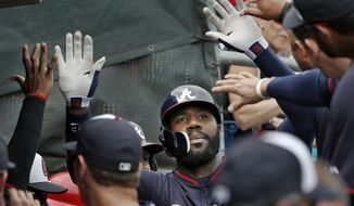 Teammates congratulate Atlanta Braves' Jason Heyward after he hit a first inning, solo home run off Philadelphia Phillies starting pitcher Cliff Lee in a spring exhibition baseball game in Clearwater, Fla., Monday, March 10, 2014.  (AP Photo/Kathy Willens)