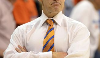 Florida coach Billy Donovan watches from the sideline late in the second half of an NCAA college basketball game against Kentucky Saturday, March 8, 2014, in Gainesville, Fla. Florida defeated Kentucky 84-65. (AP Photo/Phil Sandlin)