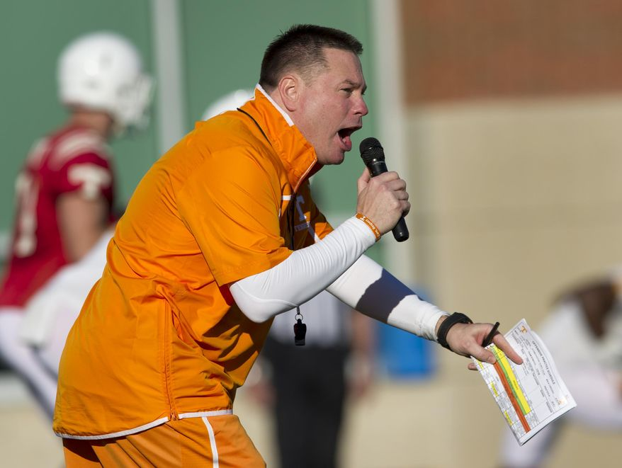Tennessee coach Butch Jones gives instruction during the team's first spring NCAA college football practice on Friday, March 7, 2014, in Knoxville, Tenn. (AP Photo/Knoxville News Sentinel, Paul Efird)
