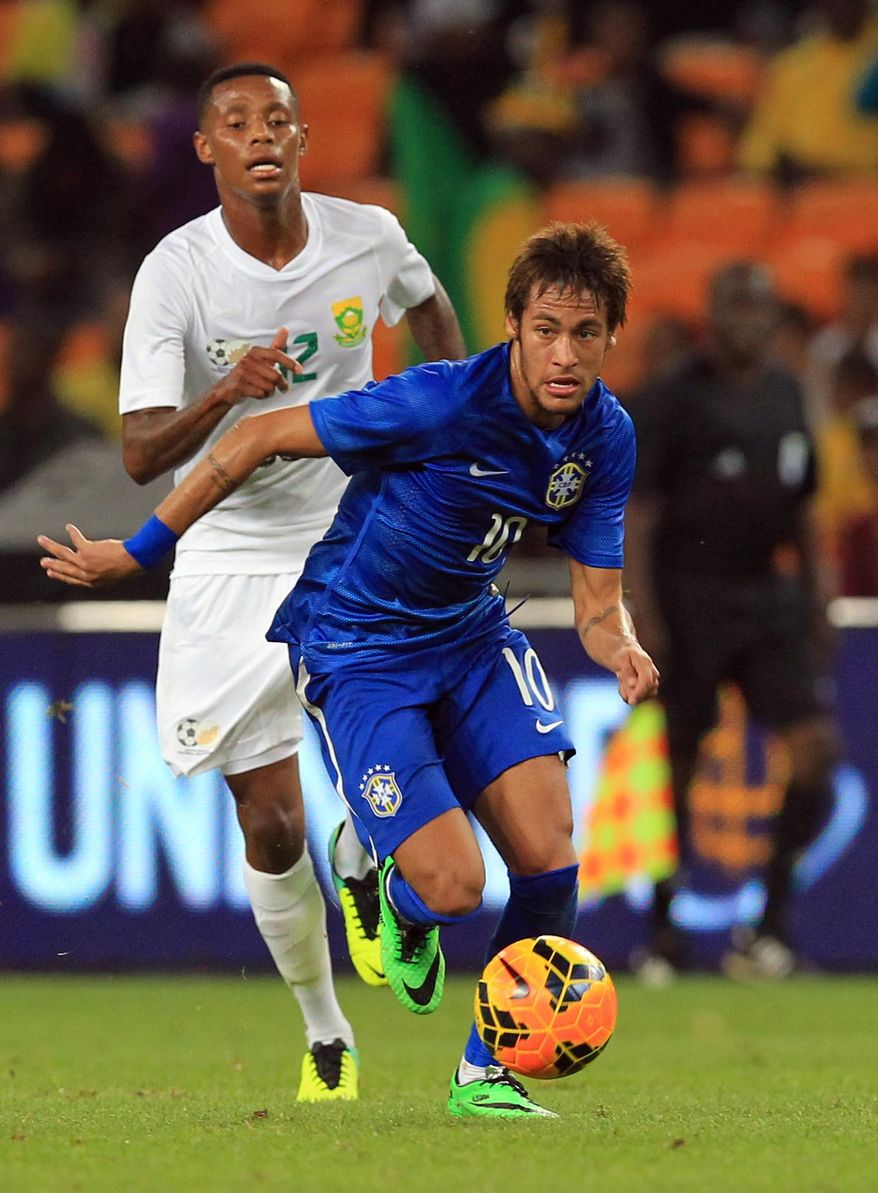 Brazil's Neymar, front, attacks as South Africa's Bongani Zungu, back, chases during their international friendly soccer match at Soccer City Stadium in Johannesburg, South Africa, Wednesday, March 5, 2014. Brazil beat South Africa 5-0. (AP Photo/Themba Hadebe)