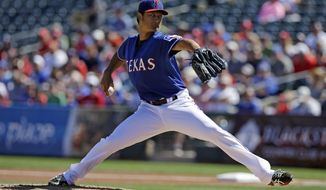 Texas Rangers starting pitcher Yu Darvish, of Japan, throws during the first inning of a spring exhibition baseball game Monday, March 10, 2014, in Suprise, Ariz. (AP Photo/Darron Cummings)