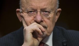 FILE - This Jan. 29, 2014 file photo shows Director of National Intelligence James Clapper on Capitol Hill in Washington. U.S. intelligence officials are planning an electronic monitoring system that would tap into government, financial and public databases to scan the behavior patterns of many of the 5 million government employees who hold secret clearances, according to current and former officials. The system draws on a Defense Department model in development for more than a decade, documents reviewed by the Associated Press show. (AP Photo/Pablo Martinez Monsivais, File)