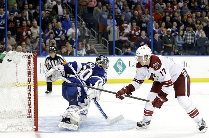 Phoenix Coyotes right wing Radim Vrbata (17), of the Czech Republic, beats Tampa Bay Lightning goalie Ben Bishop for a goal in a shoot out an NHL hockey game Monday, March 10, 2014, in Tampa, Fla. The Coyotes won the game 4-3. (AP Photo/Chris O'Meara)