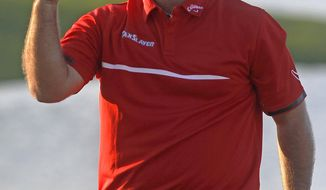 Patrick Reed celebrates his one stroke victory during the final round of the Cadillac Championship golf tournament Sunday, March 9, 2014, in Doral, Fla. Reed won the tournament with a four-under-par 284. (AP Photo/Marta Lavandier)