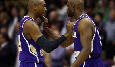 Western Carolina's Brandon Boggs, left, and Tawaski King pump each other up before the first half of the NCAA college basketball championship game in the Southern Conference tournament against Wofford in Asheville, N.C., Monday, March 10, 2014. (AP Photo/Adam Jennings)