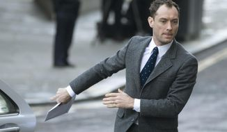 "FILE - In this file photo dated Monday, Jan. 27, 2014, British actor Jude Law arrives at The Old Bailey court in to give evidence at the phone hacking trial in London, Monday, Jan. 27, 2014. Law is nominated Monday March 10, 2014, for Best Actor award in the upcoming Olivier Awards, for his portrayal of the king in Shakespeare's ""Henry V"".  The Olivier Award winners will be announced April 13.(AP Photo/Alastair Grant, FILE)"
