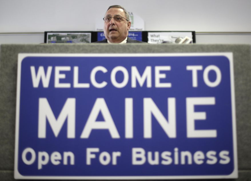 """Maine Gov. Paul LePage speaks at a news conference where he touted his """"Open for Business Zones"""" proposal, Monday, March 10, 2014, in Brunswick, Maine. The Republican governor says the zones will provide tax and energy relief, help businesses train and recruit workers, and give employees the right to opt out of paying union fees.  (AP Photo/Robert F. Bukaty)"""
