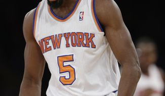 New York Knicks' Tim Hardaway Jr. (5) reacts after making a three-point basket during the second half of an NBA basketball game against the Philadelphia 76ers Monday, March 10, 2014, in New York. The Knicks won the game 123-110. (AP Photo/Frank Franklin II)