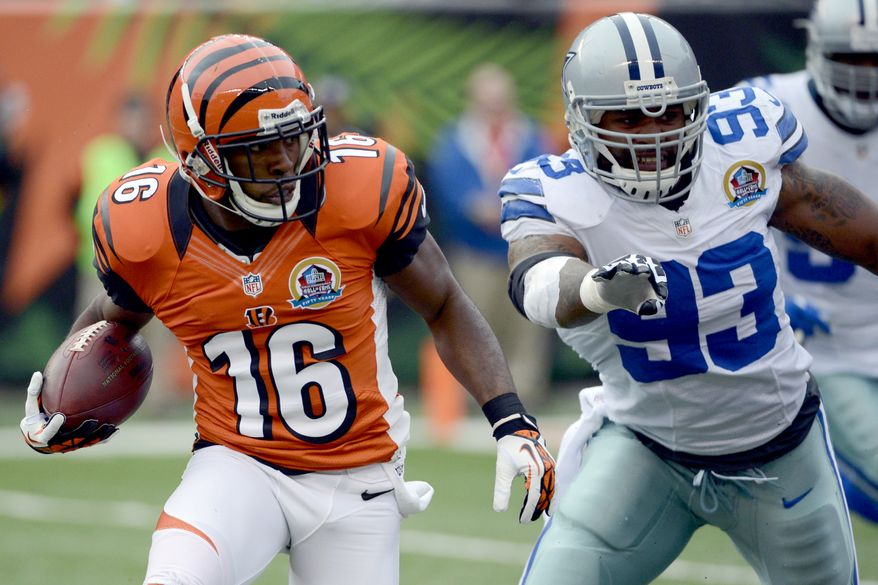 Cincinnati Bengals wide receiver Andrew Hawkins (16) runs past Dallas Cowboys outside linebacker Anthony Spencer (93) for an 8-yard touchdown after catching a pass in the first half of an NFL football game, Sunday, Dec. 9, 2012, in Cincinnati. (AP Photo/Michael Keating)