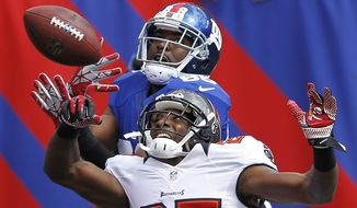 Tampa Bay Buccaneers cornerback Aqib Talib (25) breaks up a pass to New York Giants' Hakeem Nicks during the first half of an NFL football game Sunday, Sept. 16, 2012, in East Rutherford, N.J. (AP Photo/Julio Cortez)